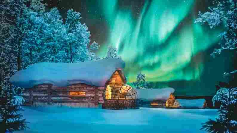 Chalé de vidro com vista para aurora boreal, Finlândia.