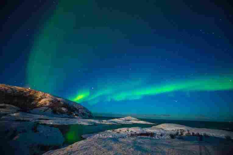 Temporada de inverno com aurora boreal, em Trømso.